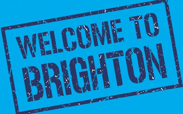text styled to look like a rubber stamp, reading 'Welcome to Brighton'