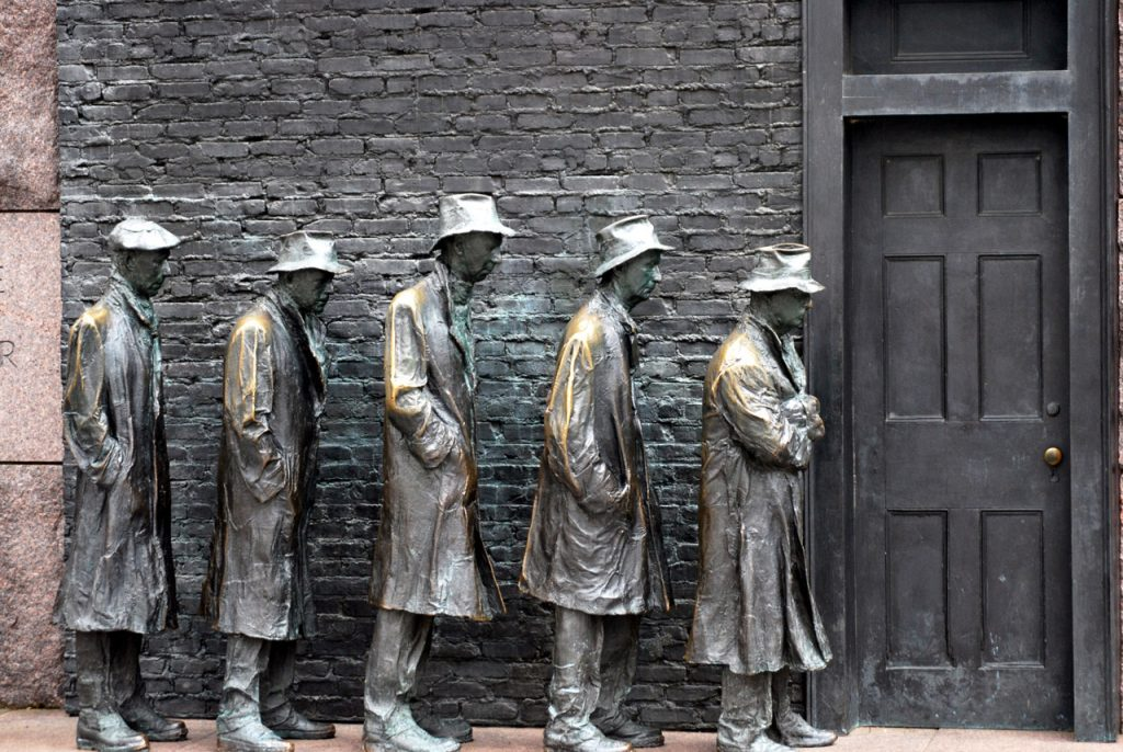 A culpture depicting 5 men in 30s garb waiting in line at a closed door