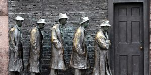 A sculpture depicting five men in Thirties garb waiting in line at a closed-door.